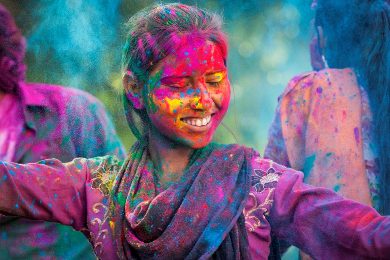 woman dancing in colours at holi